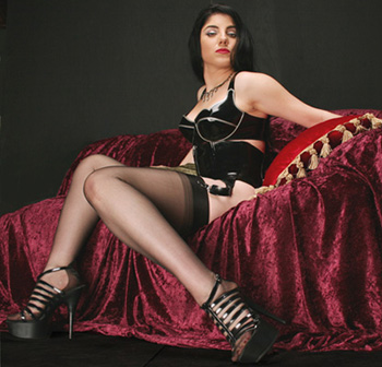 Vinyl Queen with fully-fashioned stockings.